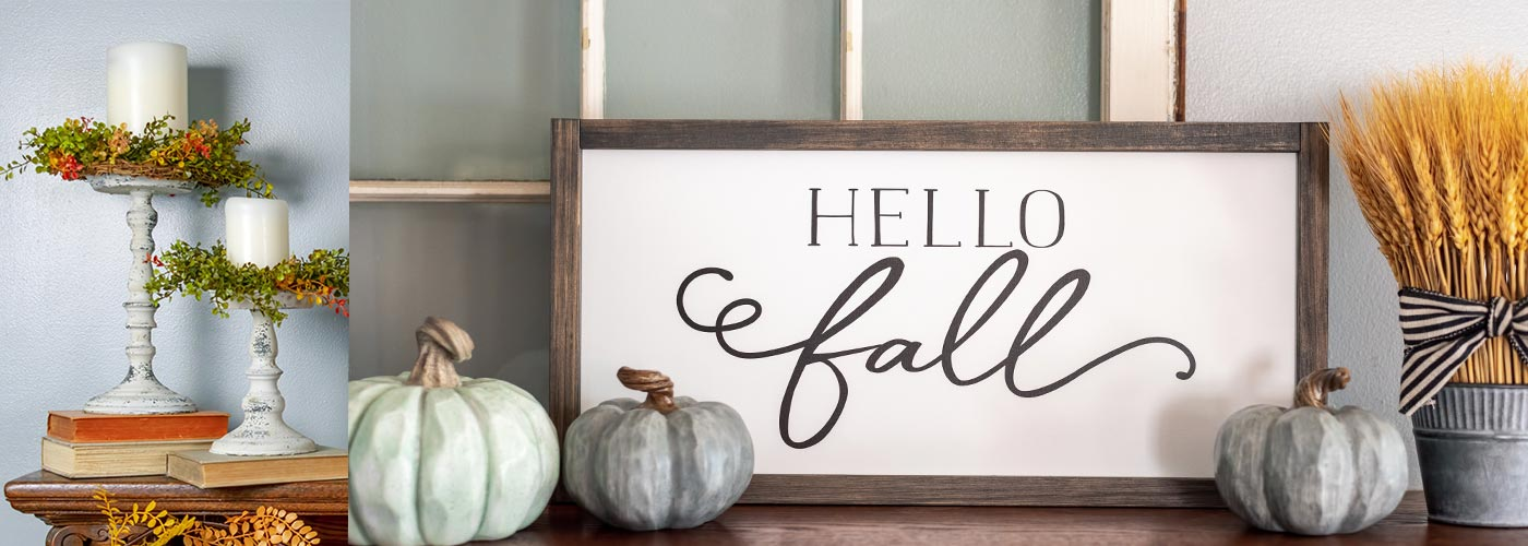 fall home decor with pumpkins, white distressed candlesticks, and a wood sign that says hellow fall